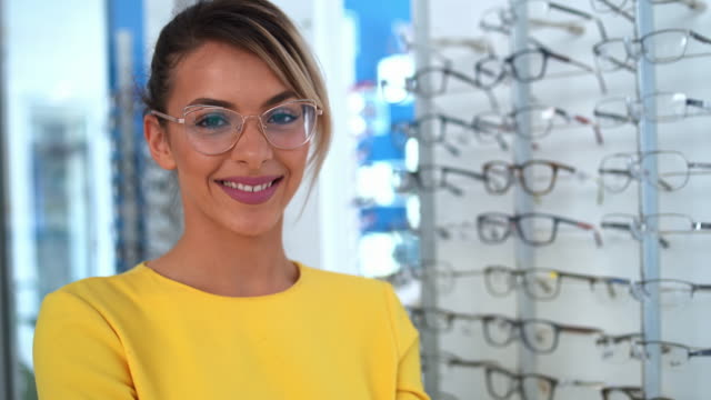 health care, eyesight and vision concept - beautiful woman at optics store - optometrist stock videos & royalty-free footage