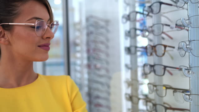 health care, eyesight and vision concept - beautiful woman at optics store - choice stock videos & royalty-free footage