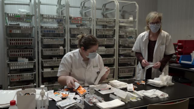 health care staffers prepare medicines for patients during the coronavirus pandemic at the hotel plaza, which is working as a hospital, on may 8,... - female nurse stock videos & royalty-free footage