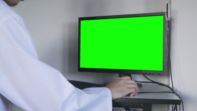 Health Care Worker with computer green screen