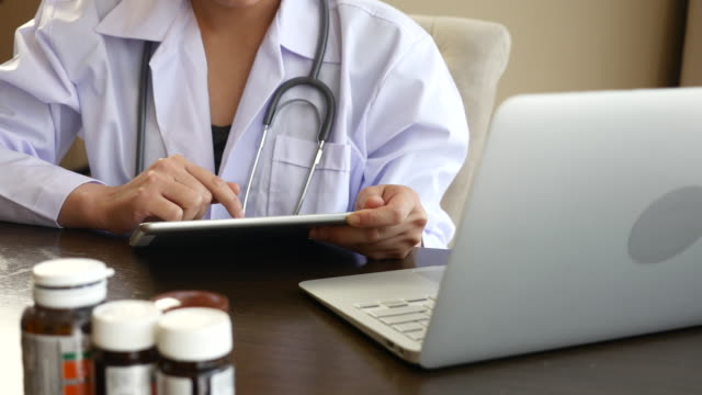 Health Care Worker working with mobile device and Laptop