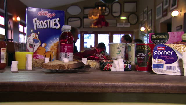 stockvideo's en b-roll-footage met health experts have joined forces to try to reduce the amount of sugar added to food and drinks the group action on sugar says just a third less... - aan elkaar bevestigd