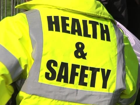 health & safety officer / hi vis flourescent jacket - occupational safety and health stock videos and b-roll footage