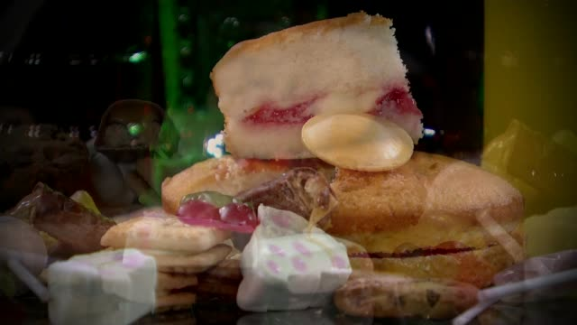health select committee calls on government to drop its opposition to a 'sugar tax' r22101501 / pile of cake jelly sweets marshmallows biscuits... - saucer stock videos and b-roll footage
