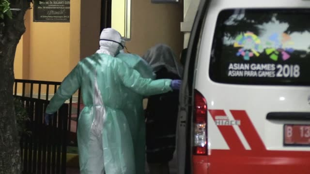 health staff arrive with patient at hospital sulianto saroso in jakarta, indonesia on march 02, 2020. indonesia confirmed its first two cases of the... - indonesia stock videos & royalty-free footage