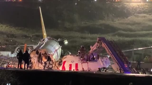 health teams and fire brigade crews are seen near debris of a passenger plane after skidded off the runway in istanbul sabiha gokcen international... - istanbul province stock videos & royalty-free footage
