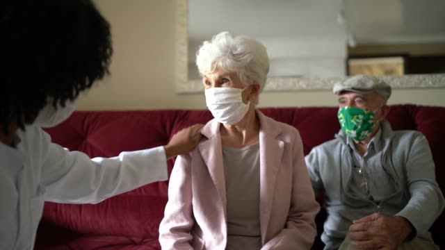 health visitor and a senior couple during home visit - listening to heartbeat stock videos & royalty-free footage