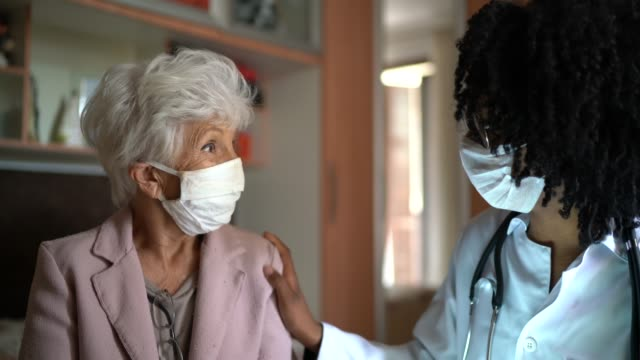 health visitor and a senior woman during home visit - visit stock videos & royalty-free footage