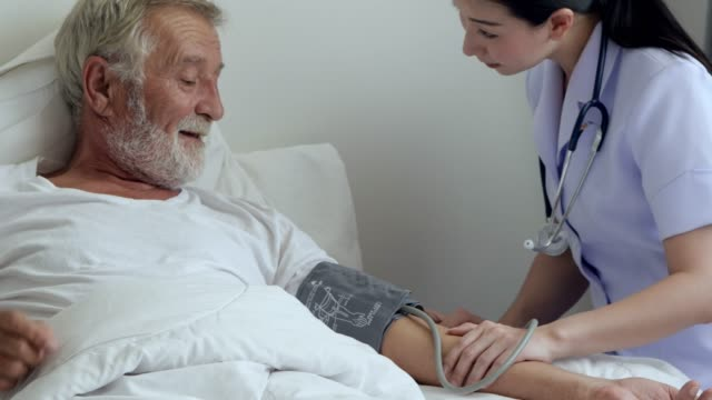 Health visitor with old patient at home