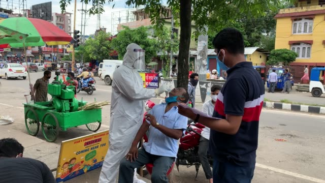 health worker collecting swab sample for covid19 coronavirus rapid antigen test, on a street, in guwahati on tuesday, 18 august 2020. - india stock videos & royalty-free footage