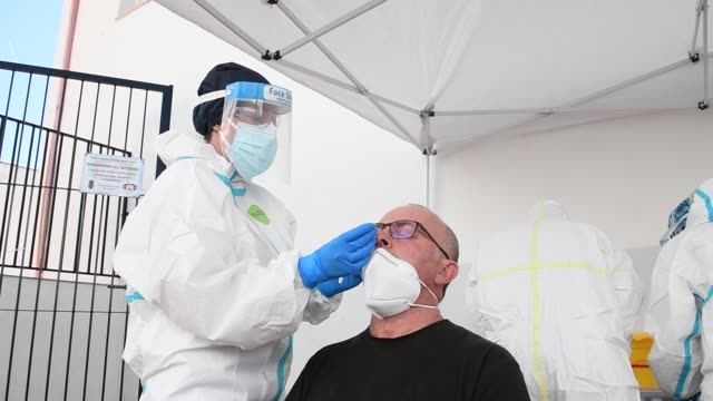 health worker performs an express test to a man to detect the coronavirus on october 08, 2020 in alfacar, spain. due to the high incidence of... - bud stock videos & royalty-free footage