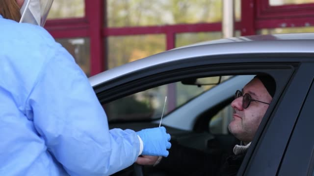 a health worker wearing personal protective equipment holds a test kit for taking a swab from the drivers on april 09 2020 in turin italy there have... - tampon stock videos & royalty-free footage