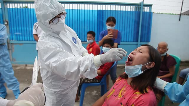 health worker wearing personal protective equipment takes a swab sample for testing for the coronavirus disease at a social institution on august 27,... - editorial stock-videos und b-roll-filmmaterial