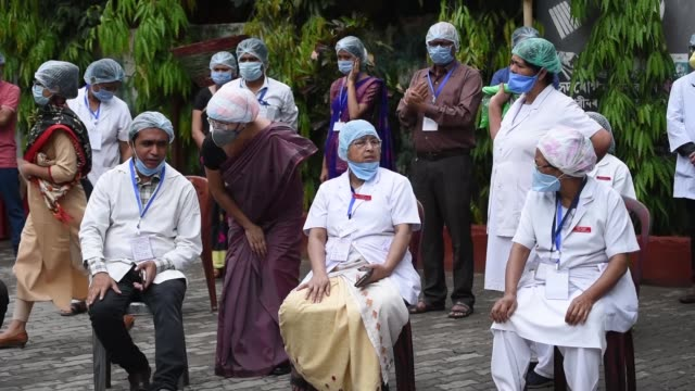 health worker wearing protective mask and head cap - nurse cap stock videos & royalty-free footage