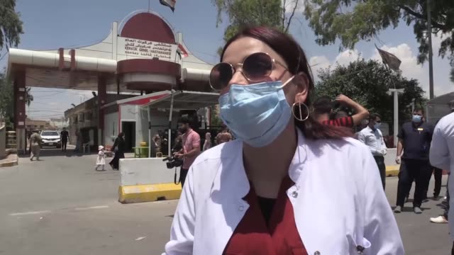 health workers in iraq's kirkuk province stage protest on june 21, 2020 against deteriorating working conditions after covid-19 pandemic across the... - iraq video stock e b–roll