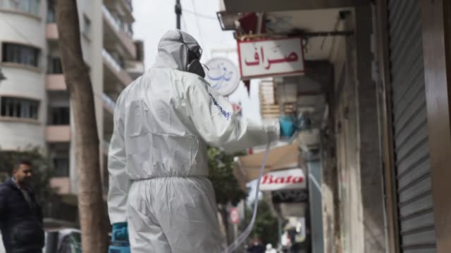 health workers in lebanon work to combat an outbreak of the novel coronavirus by spraying disinfectant into the air by truck and onto surfaces by... - cleaning agent stock videos & royalty-free footage