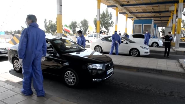 health workers measure the body temperatures of passengers and drivers as a precaution against the coronavirus is being measured in qom iran on march... - iran stock videos & royalty-free footage