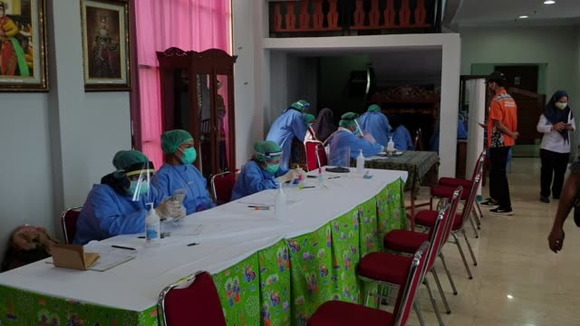 health workers of jagakarsa public health service in a swabtest center for identify coronavirus cases in jakarta indonesia on july 29 2020 - grooming product stock videos & royalty-free footage