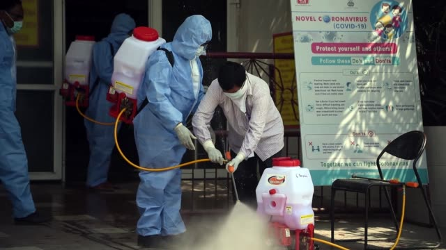health workers preparing disinfectant to spay - disinfection stock videos & royalty-free footage