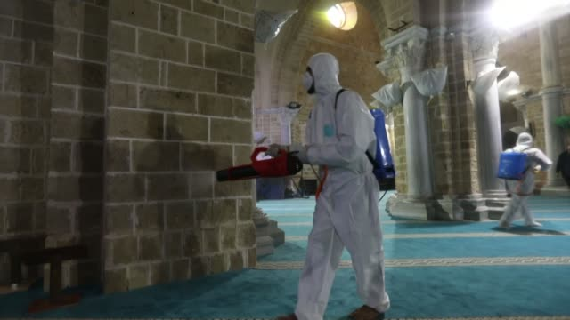health workers spray disinfectant inside and outside al-omari mosque in gaza city as a preventive measure amid fears of the spread of coronavirus in... - palestinian stock videos & royalty-free footage