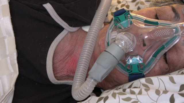 healthcare: cpap, senior adult woman sleeping and wearing a mask that improves her sleeping - sleep apnea stock videos and b-roll footage