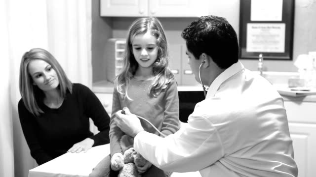 Healthcare. Little girl patient with pediatrician doctor. Check-up, exam.