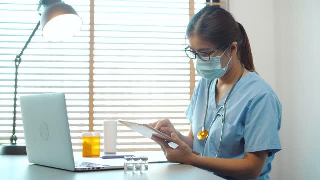 healthcare office nurse using digital tablet - administrator stock videos & royalty-free footage