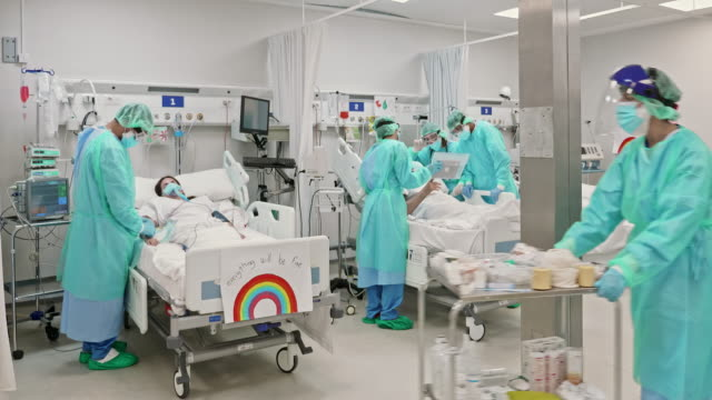 healthcare people working at icu during the pandemic - protection stock videos & royalty-free footage