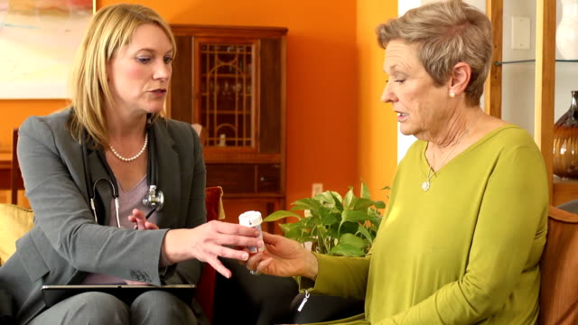 Healthcare Professional Discusses Medication with Patient