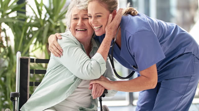 healthcare with a hug - healthcare worker stock videos & royalty-free footage