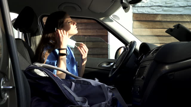 a healthcare worker commuting home inside a car. - day in the life stock videos & royalty-free footage