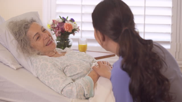 healthcare worker consoling senior patient - grey hair stock videos & royalty-free footage