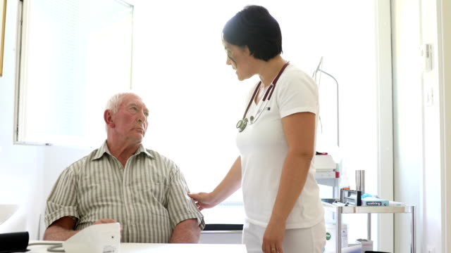 healthcare worker doing a medical check-up on senior man - medicaid stock videos and b-roll footage