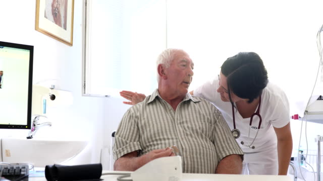 Healthcare Worker Doing a Medical Check-up on Senior Man