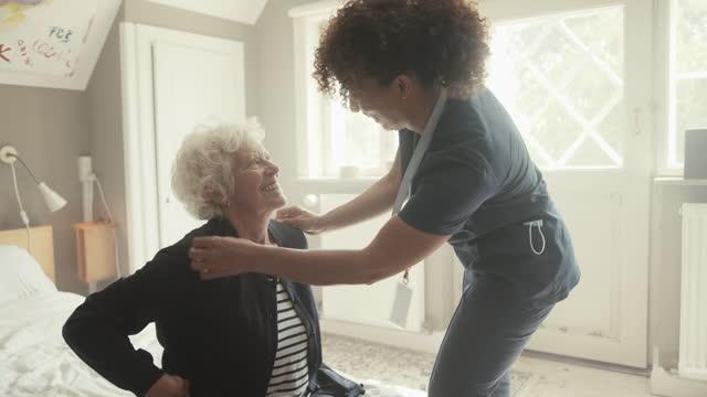 healthcare worker helping senior woman - bathrobe stock videos & royalty-free footage