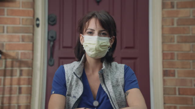 ms healthcare worker portrait outside her home - staring stock videos & royalty-free footage