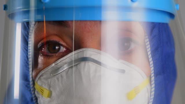 healthcare worker speaking during coronavirus covid 19 novel corona virus outbreak - female doctor stock videos & royalty-free footage