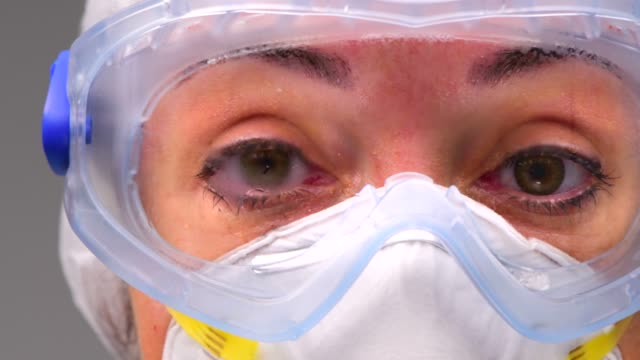 healthcare worker tired, sweaty and exhausted in protective suit during coronavirus covid 19 novel corona virus outbreak - nurse working stock videos & royalty-free footage