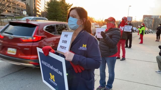 healthcare workers and supporters protest for better distribution of personal protective equipment for frontline workers during the covid19 crisis on... - michigan stock videos & royalty-free footage