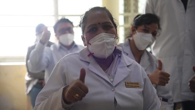 healthcare workers gives thumbs up after receiving an oxford-astrazeneca's covid-19 vaccine, called covishield, during the coronavirus disease... - happiness stock videos & royalty-free footage