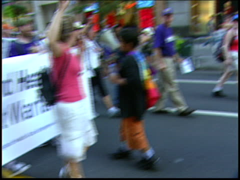 Healthcare workers march with a megaphone during the 2004 RNC antiwar protests in NYC