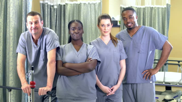 healthcare workers standing in hospital ward - side by side stock videos & royalty-free footage