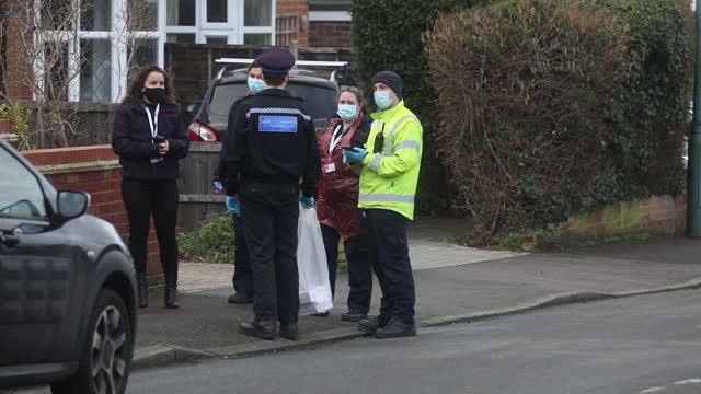 healthcare workers talking to police officer during door to door testing of south african covid-19 strain in maidstone, kent, u.k. on tuesday,... - rear view stock videos & royalty-free footage