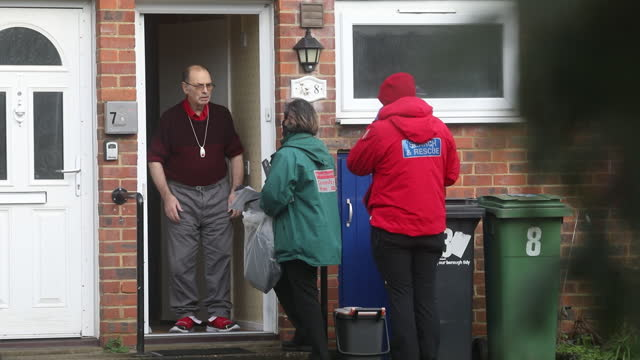 healthcare workers talking to senior man in front of his house during door to door covid-19 testing of south african strain in maidstone, kent, u.k.... - senior men stock videos & royalty-free footage