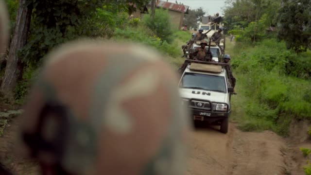 healthworkers, being escorted to ebola outbreak by armed un forces in beni, democratic republic of congo - democratic republic of the congo stock videos & royalty-free footage