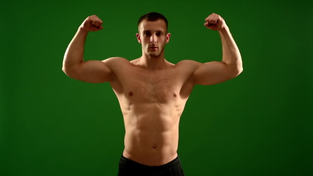 healthy athlete  with nice muscle on green  background - one man only stock videos & royalty-free footage