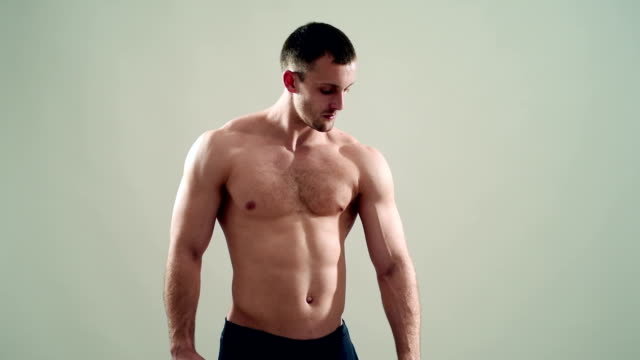 healthy athlete  with nice muscle on grey  background