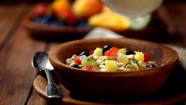 healthy breakfast muesli with fruits - oatmeal stock videos & royalty-free footage