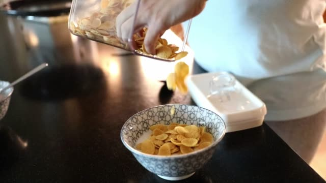 healthy breakfast of corn flakes - bowl stock videos and b-roll footage