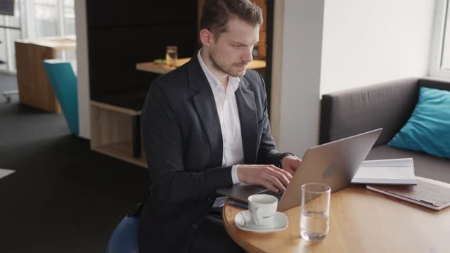 healthy caucasian businessman sitting on a yoga ball while working on a laptop - fitness ball stock videos & royalty-free footage